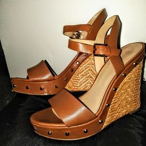 Michael Kors studded wicker wedge heels.